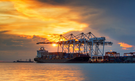 Cargo_ship_at_port_with_sunset