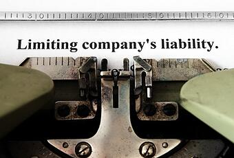 Limiting_companys_liability-on_typewriter